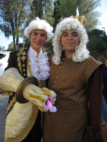 The Boy as Lumiere along with Cogsworth
